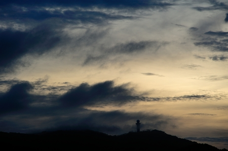 enveloped: Thick clouds enveloped the radar station at sunrise Stock Photo