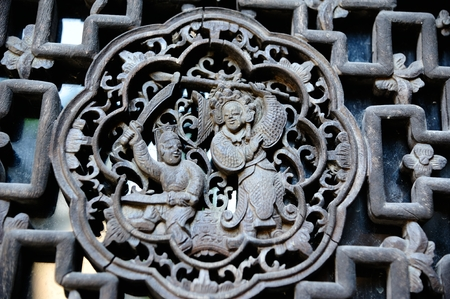 generals: Ancient Chinese wood carving bars generals fight scene