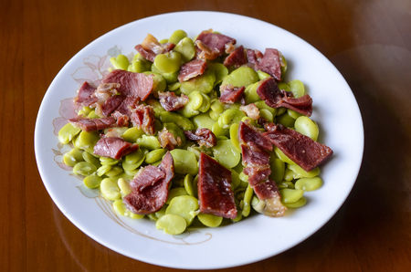 collocation: Steamed broad beans with ham Stock Photo
