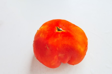 deformity: Tomato close-up in water Stock Photo