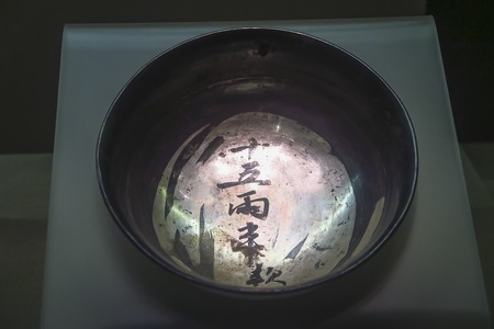 Plain silver bowl with folded belly