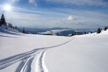 snowy mountain panorama with snow trails Stock Photo - 9153304