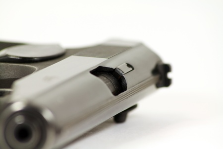Pistols barrel. The pistol laying on a table. photo