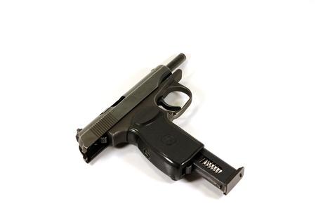 Makarov pistol disasembled on white background photo