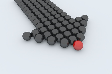 One red ball and black balls created arrow. Symbolize leadership and teamwork. photo