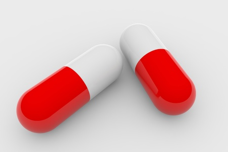 depressant: Two red and white pills on white surface.