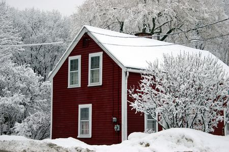 white winter: Red house among trees under snow
