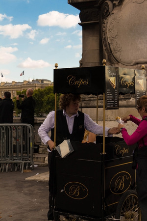 iii: Paris, France-september 19, 2015: The unidentified  crepes seller near the bridge of Alexandre III, Paris, France Editorial