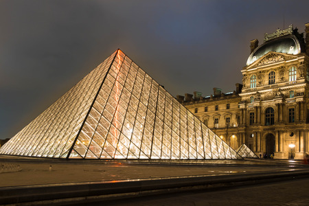 louvre pyramid: Paris, France, October 15, 2015: The Louvre Pyramid based in the main courtyard of the Louvre Napoleon Court Palace in Paris, France.It reserves as the main entrance to the Louvre Museum.Completed in 1989. It has Become a landmarkof the city of Paris.