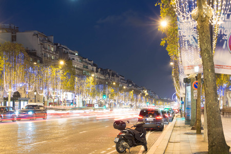 champs elysees: Paris; France-November 23, 2015 : The Christmas decoration on Champs Elysees avenue, blurred motion cars in Paris, France. Editorial