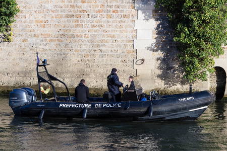 patrolling: Paris; France-November 28, 2015 : The Police boat is patrolling on the Seine river near Notre Dame cathedral in Paris, France.