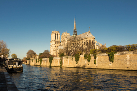 ile de la cite: paris; France-November 28, 2015 : The Notre Dame cathedral is a historic catholic  cathedral on the eastern half of the ile de la Cite in the 4th arrondissement of Paris.It is the largest and most well known church buildings in the world.