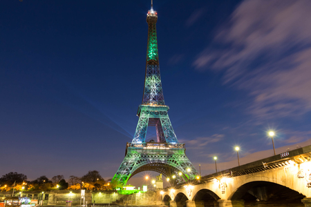 visual: Paris; France-December 02, 2015: The Eiffel tower covered by a green visual forest as part of the organisation of the Conference on climate COP 21 that gathers 193 countries in Paris from November 30 to December 11, 2015.