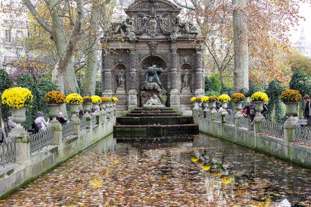 jardin de luxembourg: Paris; France-November 07, 2015 : The Medici Fountain is a monumental fountain in the Jardin du Luxembourg in the 6th arrondissement of Paris.It was built in about 1630 by Marie de Medici, the widow of King Henry IV.
