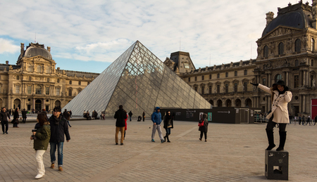 louvre pyramid: Paris; France, November 22, 2015: The Louvre pyramid is a wide glass and metal pyramid in the main courtyard of the Louvre courtyard Napoleon Palace in Paris.The wide pyramid reserves as the main entrance to the Louvre museum.