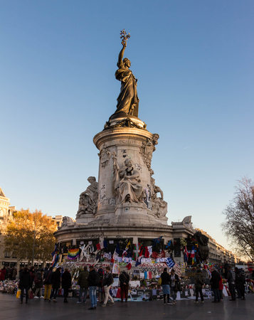 commemoration: Paris; France-December 04, 2015: The statue of Mariannewho symboloises the spirit of the French Republicbedecked with banners and placards in commemoration of the victims 13 November terrorist attacks.