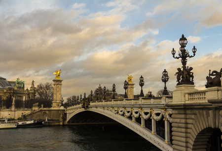 champs elysees quarter: Paris; France-December 21; 2015:The bridge Alexandre III is a deck arch bridge that spans the Seine in Paris.It connects the Champs Elysees quarter with those of the Invalides and Eiffel tower.It is classified as a French Historical Monument.
