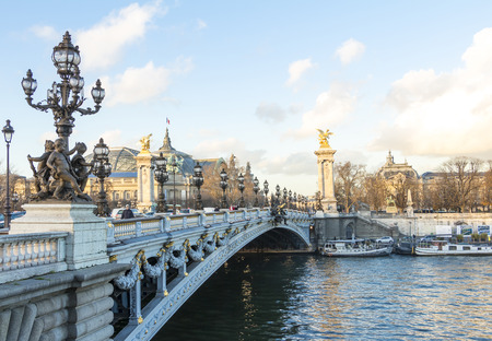 monument historical monument: Paris: France-December 12; 2015: The bridge Alexandre III is a deck arch bridge that spans the Seine in Paris.It connects the Champs Elysees quarter with those of the Invalides and Eiffel tower.It is classified as a French Historical monument.