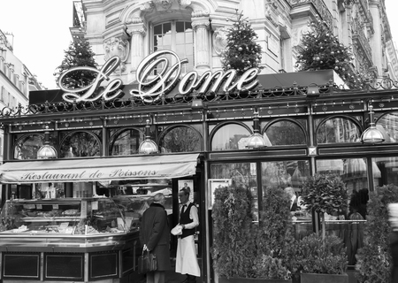 frequented: Paris; France, January 02, 2015: The restaurant Le Dome Located on Boulevard Montparnasse in Paris.Opening in 1898. It was the first cafe in Montparnasse.It Such Was frequented by the famousand soon be famous painters, sculptors, writers, poets ... Later  Editorial