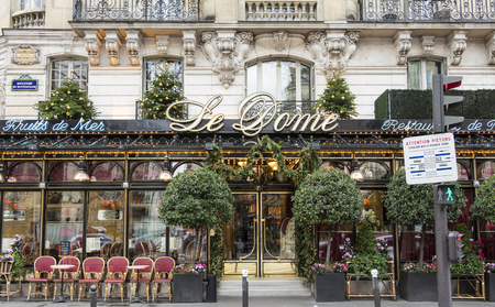 frequented: Paris; France, January 02, 2015: The restaurant Le Dome Located on Boulevard Montparnasse in Paris.Opening in 1898. It was the first cafe in Montparnasse.It Such Was frequented by the famousand soon be famous painters, sculptors, writers, poets ... Editorial