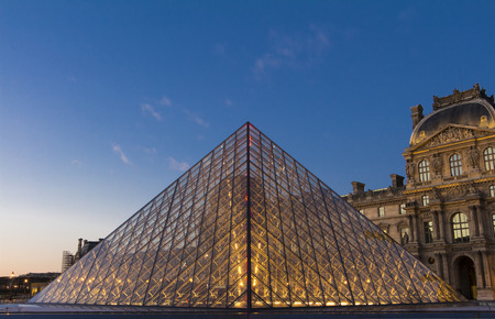 louvre pyramid: Paris, France-January 15, 2016 : The Louvre Pyramid based in the main courtyard(cour Napoleon) of the Louvre Palace in Paris, France.It serves as the main entrance to the Louvre museum.
