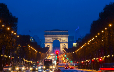 The Triumphal Arch andChamps elysees avenue at night, Paris, France.