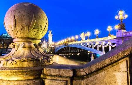The famous Alexandre III bridge at night, Paris, France. Stock Photo