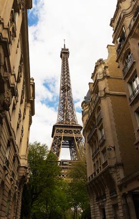 The famous Eiffel tower and parisian houses , Paris, France.