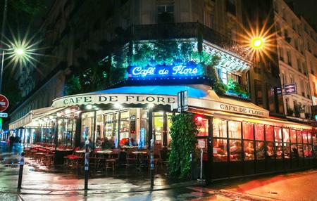 hemingway: The famous cafe de Flore at rainy night, Paris, France.