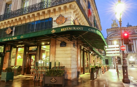 Paris, France-May 08, 2017: The famous cafe de la Paix located near opera house -Garnier palace in Paris, France. It had been inaugurated on May 5th , 1862. Editorial