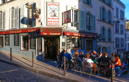 round chairs: The View of typical paris cafe Au tour du moulin in Paris, Montmartre area , France. Editorial