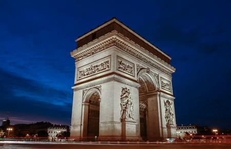 champs elysees: The Triumphal Arch at night, Paris, France.