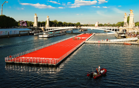 The floating race track installed on Seine river near Alexandre III bridge in Paris, France . Editorial