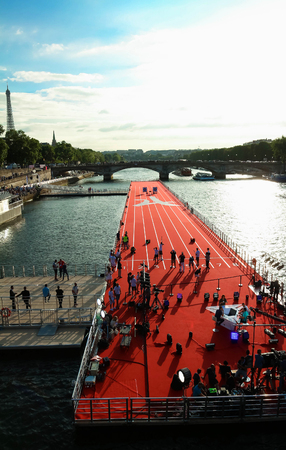 floating bridge: The floating race track installed on Seine river near Alexandre III bridge in Paris, France . Editorial