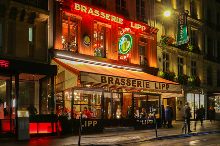 The famous brasserie Lipp at night , Paris, France. Editorial