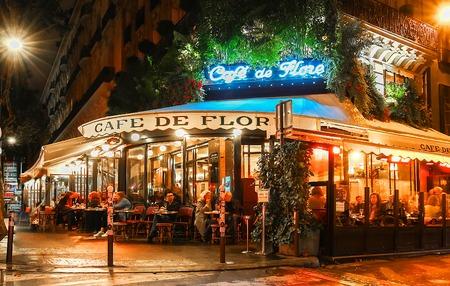 The famous cafe de Flore at rainy night, Paris, France.