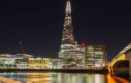 pyramidal: London, United Kingdom-August 10, 2017: The view of Shard, a 95-storey skyscraper in Southwark, London.It is the glass clad pyramidal tower with 72 habitable floors.