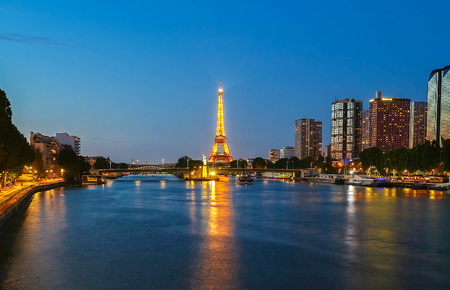 PARIS - 07 JULY,2017: Eiffel Tower in the Dusk on July 07, 2017. The Eiffel tower is the most visited monument of France located oh the bank of Seine river in Paris, France. Editorial