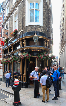 The traditional English pub Courage located in Saint Paul quarter, London, UK. Editorial