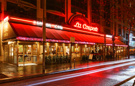 The famous cafe La Coupole decorated for Christmas at night, Paris, France.