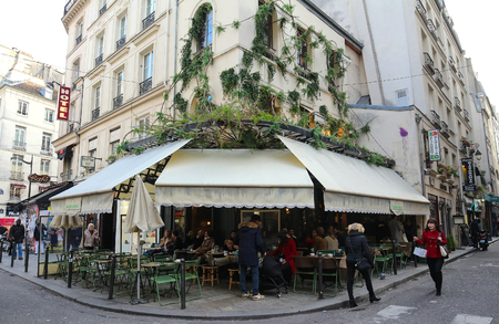 The traditional French cafe Maison sauvage decorated for Christmas, Paris, France. Editorial