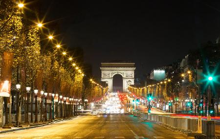 TheTriumphal arch and Champs Elysees avenue,Paris.
