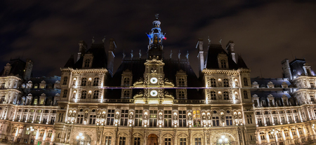 Panoramic view of town hall of Paris at night.