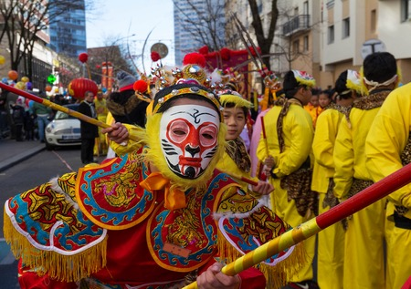 PARIS, France - FEBRUARY 25, 2018: Chinese boy with traditional opera costume in the parade. The Main Chinatown parade is the biggest and most popular of the annual parades for the Chinese new year.