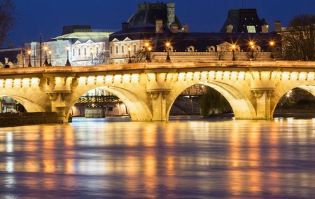 The Pont Neuf New Bridge and Seine river at night , Paris, France. Stock Photo