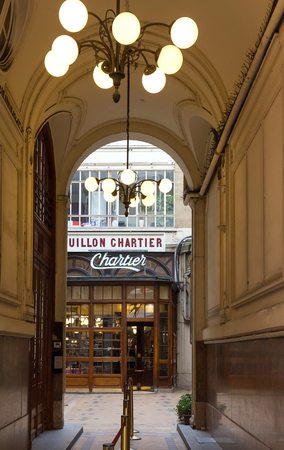 Entrance of the Bouillon Chartier - historic restaurant founded in a former train station in 1896, classified as monument, Paris, France.