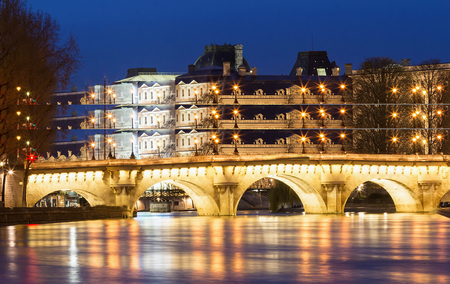 The Pont Neuf New Bridge and Seine river at night , Paris, France. Reklamní fotografie