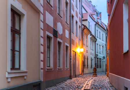 Night in center of old Riga - the capital of Latvia and famous Baltic city .