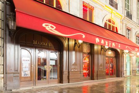 The famous restaurant Maxim at rainy night, Paris, France. Editorial