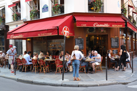 View of typical French cafe Camille in the quarter Marais, the historic Parisian district set on the Right Bank . Editoriali